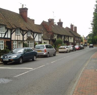 image of old thatched houses down a street in the village of Brasted, Kent where Direct Timber is based.