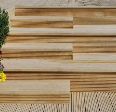 view of hardwood decking that has been made into steps on the end of the decking.