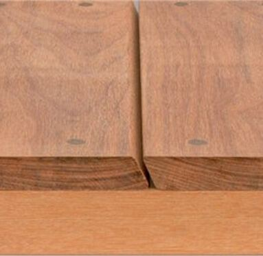 close up side view of iDeck fixing on decking boards that has invisible plugs to cover screws.