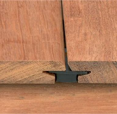 close up side view of iDeck decking clip that connects decking boards from the underside.