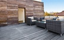 view of a decking outside of a house with garden furniture on.